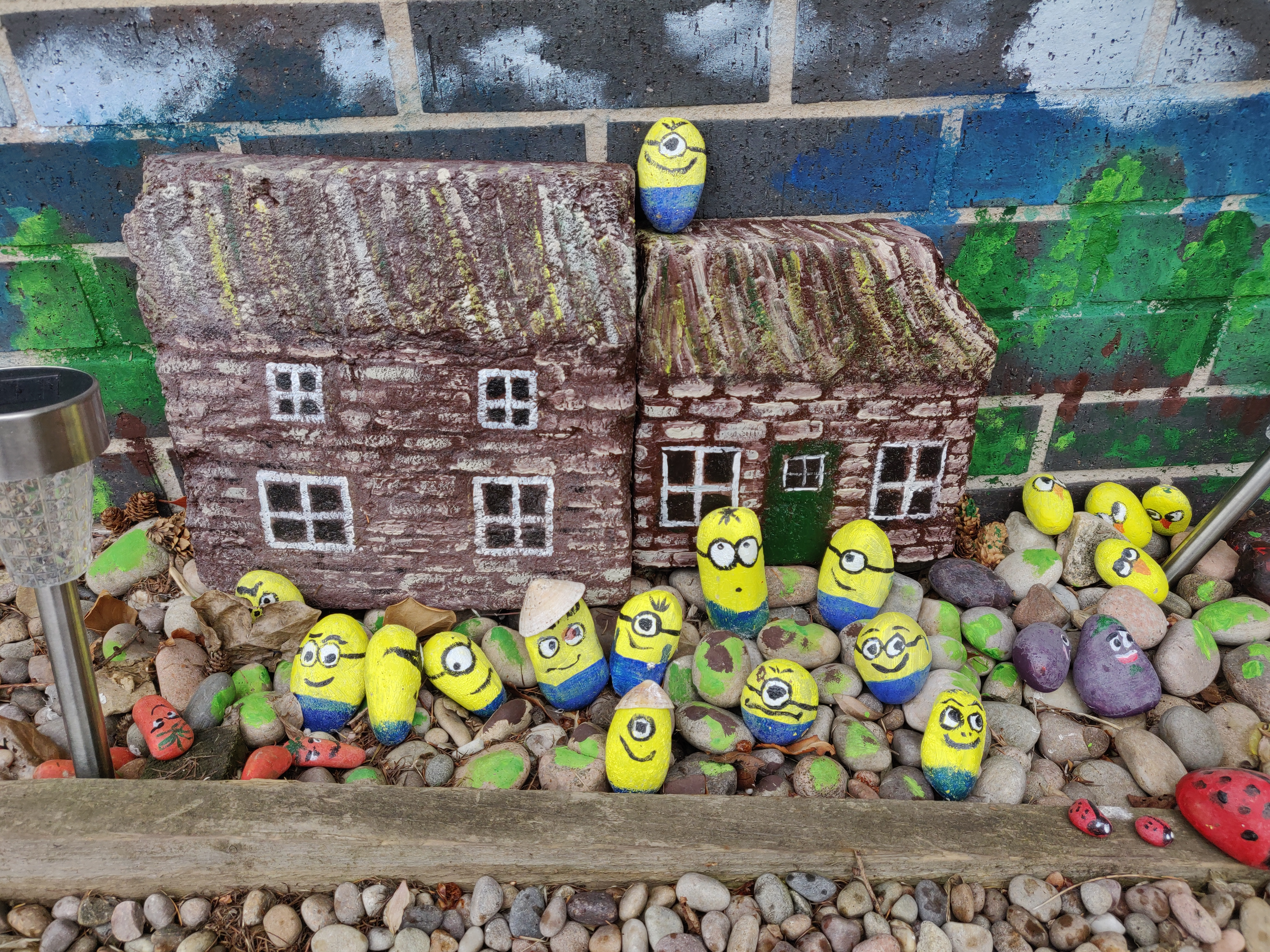 Stones painted to look like Minions