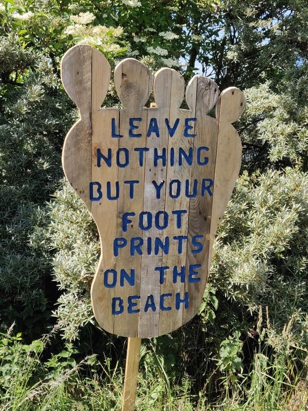Footprint shaped sign at Gullane Bents