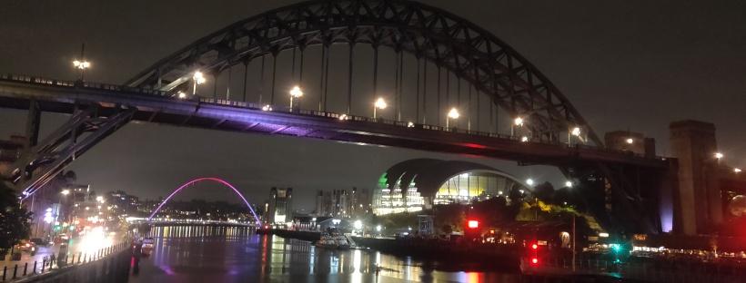 Nighttime view of the Tyne and Gateshead Millenium Bridges.